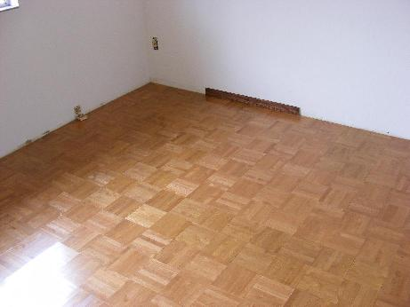 Parquet Solid Wood Floor Installation in a Bedroom