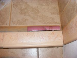 Idea Two - Use a Quarter Round Ceramic Tile Trim Piece on the perimeter Interior