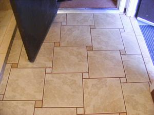 Finished Utility Room Entrance and Interior Door Ceramic Floor Tile