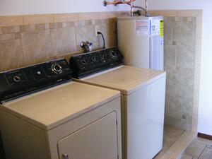 Utility Room Remodel with Catch Basin and Wraparound Ceramic Tile Wall